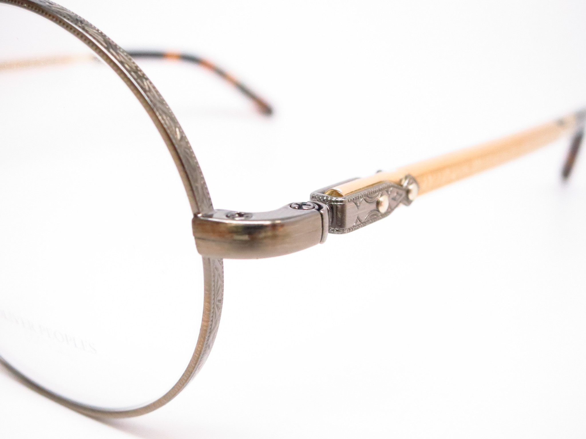 02846c89e47 ... oliver peoples ov1190 5039 eyeglasses-3 Beautifully etched metal  pieces  caption  The round shaped frame on Oliver Peoples Overstreet OV  1190 eyeglasses ...